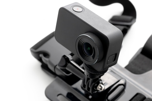 Extreme action camera with chest mount isolated on a white background.