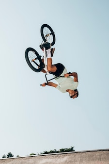 Extreme bicycle rider performing dangerous jumps