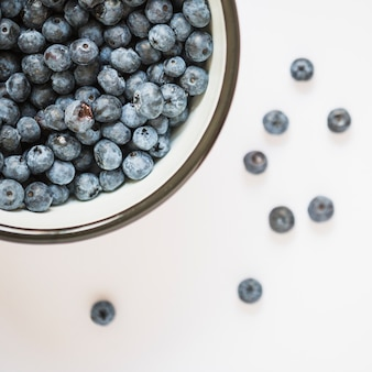Extreme close-up of blueberries bowl on white background
