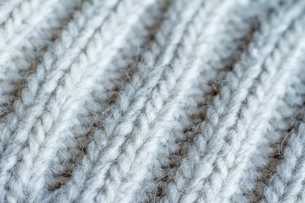 Extreme close-up gray color knitted sweater made of natural wool texture