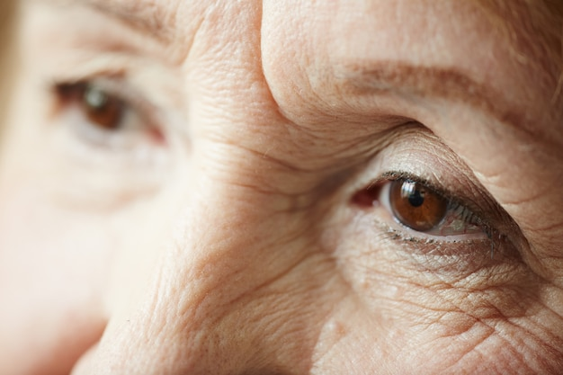 Extreme close-up of sad elderly woman