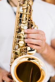 Extreme close up saxophone played by musician