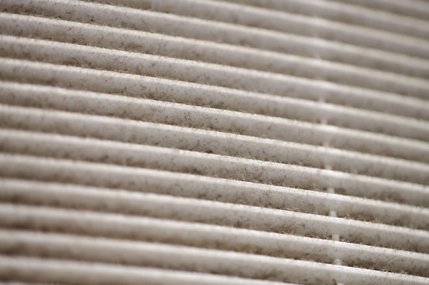 Extremely dirty air ventilation grill of hvac with dusty clogged filter, macro. close up. cleaning and disinfecting is needed to prevent dust allergies and risk of other lung illnesses