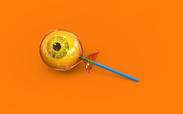 オレンジの背景にアイボールハロウィーンキャンディー