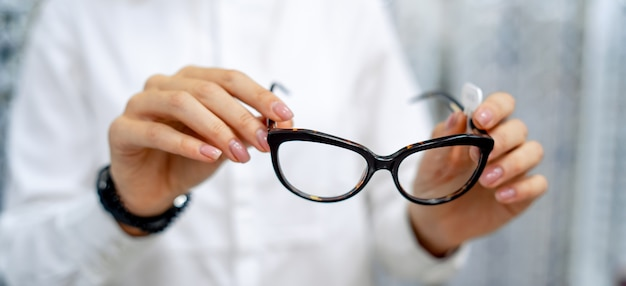 Eye-cat eyeglasses in hands close up
