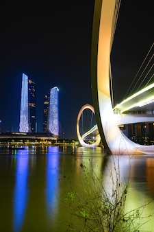 Eye of nanjing pedestrian bridge and urban skyline in jianye district, nanjing, china