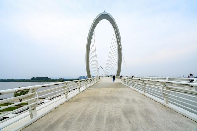 Eye of nanjing pedestrian bridge and urban skyline in nanjing, china