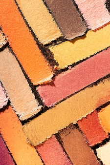 Eye shadow multi colored red orange yellow smudge loose background