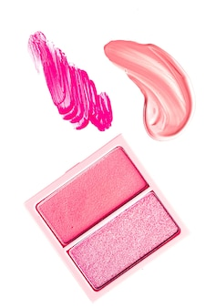 Eye shadow powder or blush makeup palette as flat lay pink cosmetic smear eyeshadow and lip gloss is...