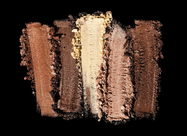 Eye shadow shimmering matte multi colored nude brown palette texture background