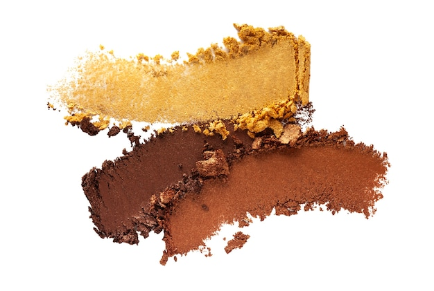 Eye shadow shimmering matte multi colored yellow golden brown nude palette texture background white isolated