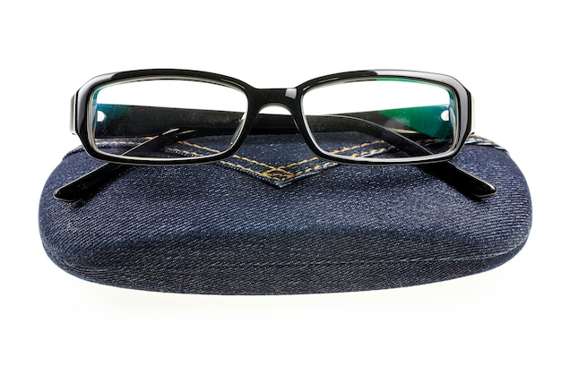 Eyeglasses and jeans case on white