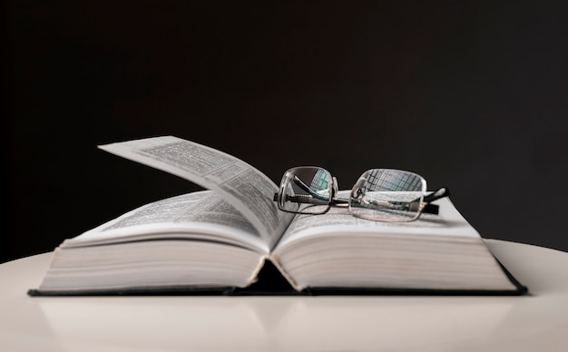 Eyeglasses over open book. education concept with copy space.
