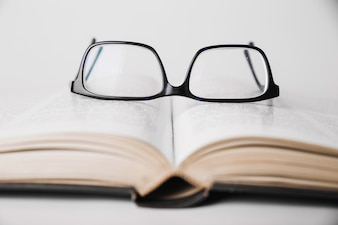 Eyeglasses placed on book