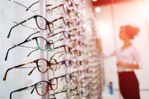 Eyeglasses shop. stand with glasses in the store of optics.