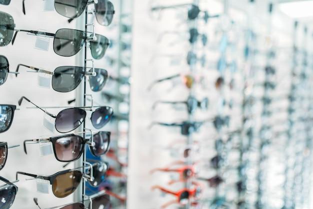 Eyeglasses and sunglasses showcase in optic shop