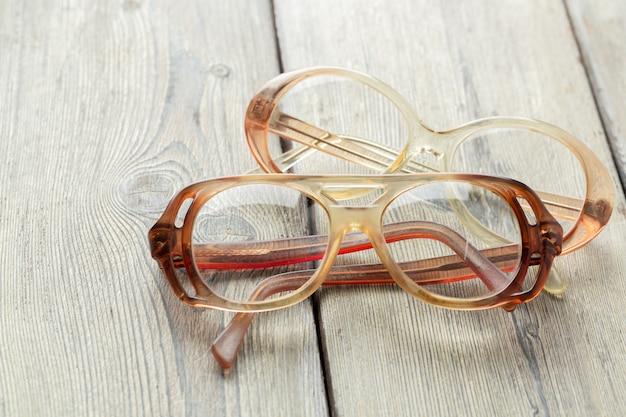 Eyeglasses on wooden table