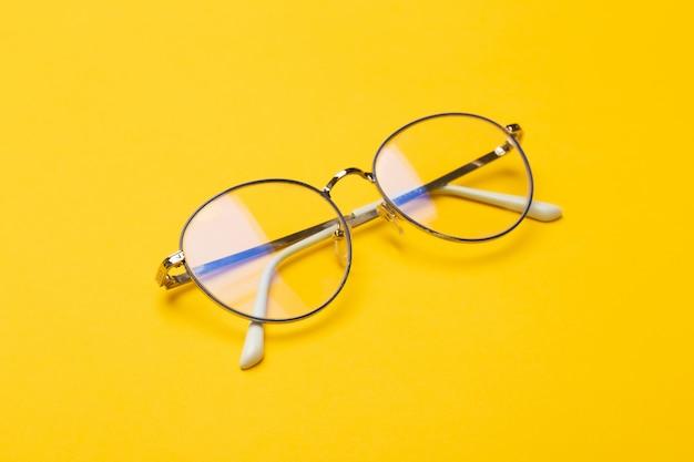 Eyeglasses on yellow background