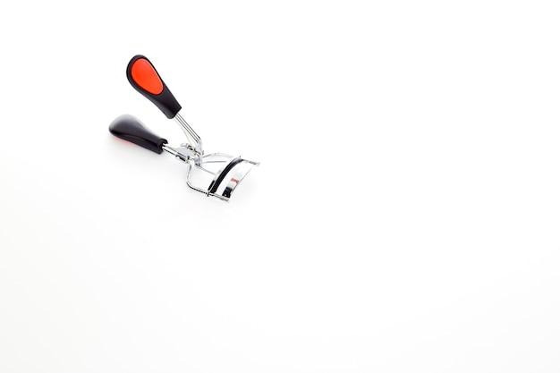 Eyelash curler on white background