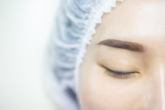Eyelash extension. beautiful woman asia with long lashes in a beauty salon.