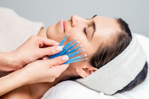Eyelash extension disposable microbrushes in hands.