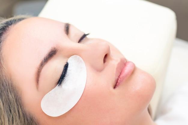 Eyelash extension procedure close up
