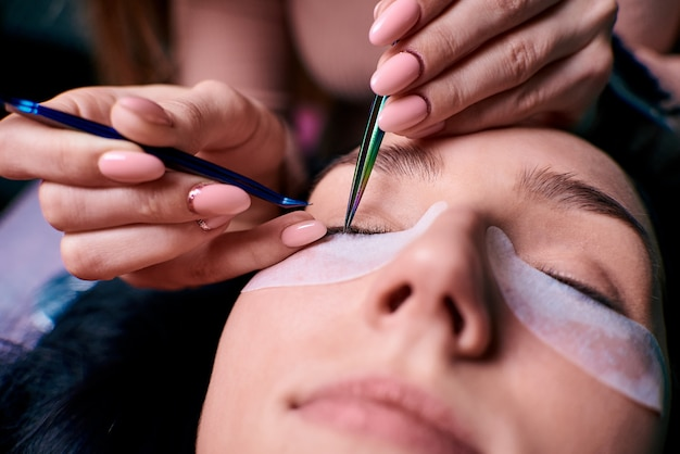 Eyelash extension procedure close up