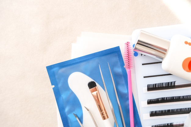 Eyelash extension procedure. tools. glue, tweezers, brushes. beauty salon, fashion and woman make up concept