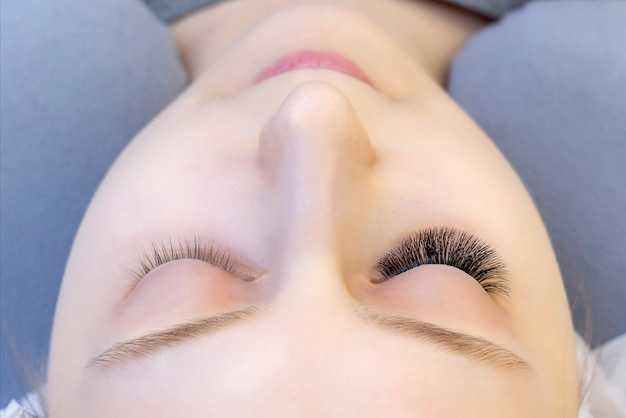 Eyelash extensions. closeup of eyes with extended eyelashes and without extended eyelashes. before and after