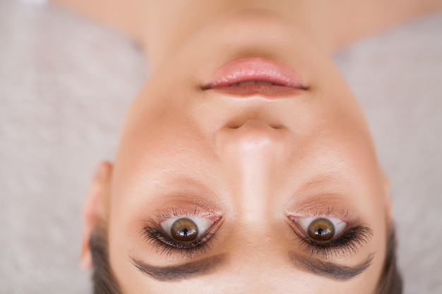 Eyelashes extensions. fake eyelashes. eyelash extension procedure. professional stylist lengthening female lashes.