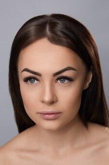 Eyelashes extensions, fake eyelashes, portrait of sexy girl with long fake eyelashes and perfect make-up,
