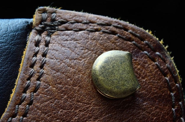 Eyelet for laces on a brown boot