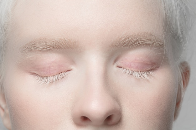 Eyelids. close up portrait of beautiful albino female model. parts of face and body. beauty, fashion, skincare, cosmetics, wellness concept