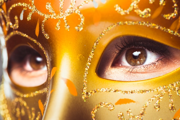 Eyes of woman in golden mask