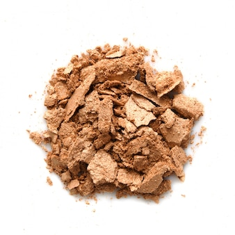 Eyeshadow sample isolated. crushed golden eyeshadow. the concept of fashion and beauty industry.