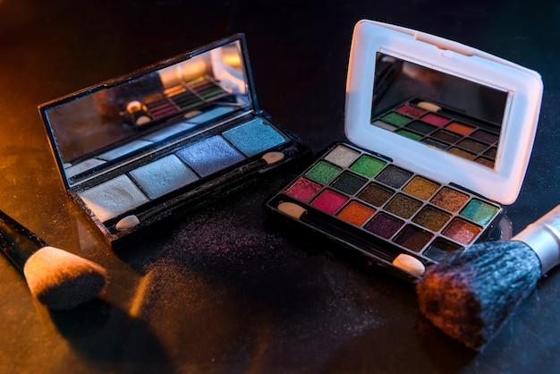 Eyeshadow set with brushes on black background