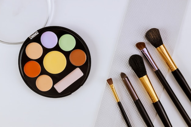 Eyeshadows and blushes on cosmetics as glamour make up products for luxury flat lay design