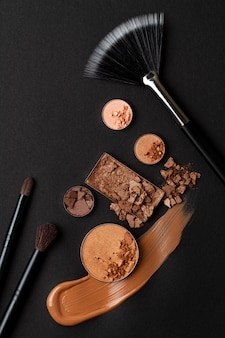 Eyeshadows, foundation, lipstick and face powder. make up artist, beauty salon, beauty blog