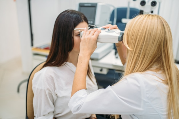 Eyesight test in optician cabinet, ophthalmology