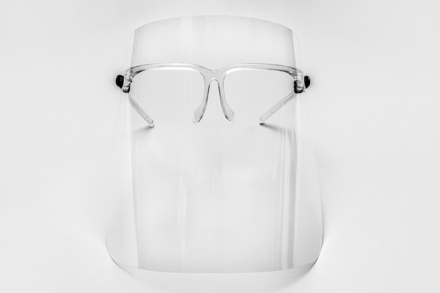 Eyewear with detachable face shield on a gray