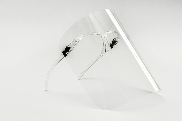 Eyewear with detachable face shield on a white