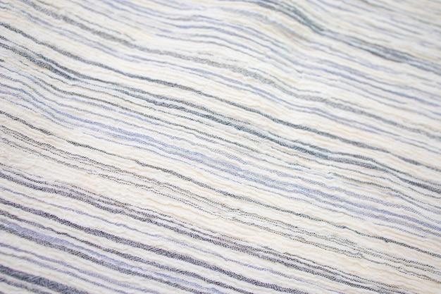 生地の背景白いリネンキャンバスしわくちゃの天然綿生地天然の手作りリネン上面図の背景オーガニックエコテキスタイル白い生地のリネンの質感