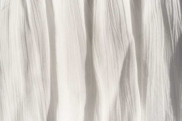 Fabric background texture  thin fabric, with vertical uneven folder.