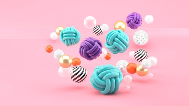 Fabric balls among colorful balls on pink space