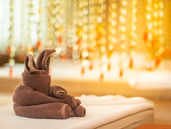 Fabric folded in animal shape in vintage massage room.