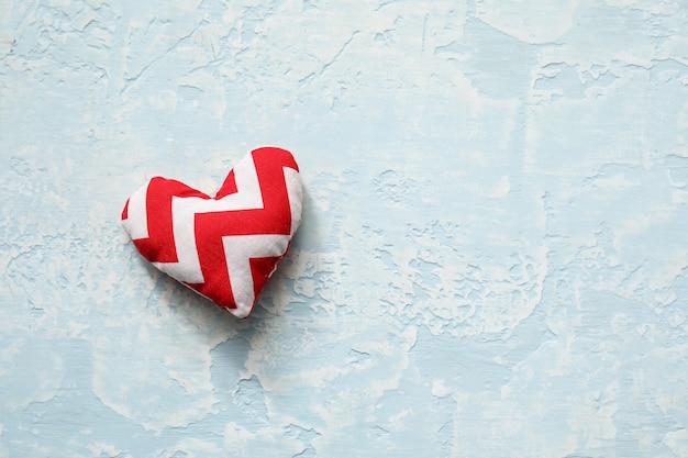 Fabric heart on light background
