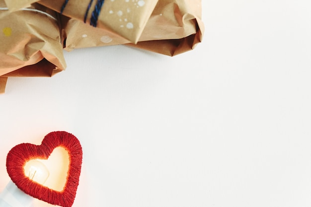 Fabric heart with a white envelope and brown packages