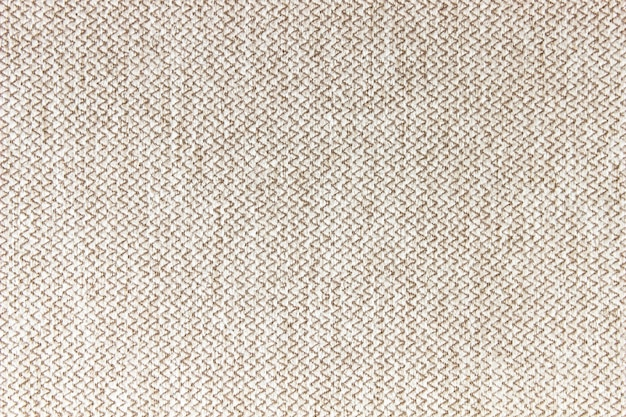 The fabric is beige.background, fabric texture.