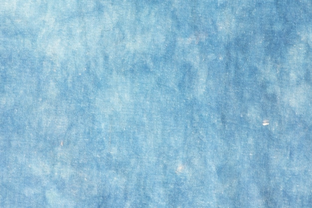 The fabric is indigo dye abstract background.
