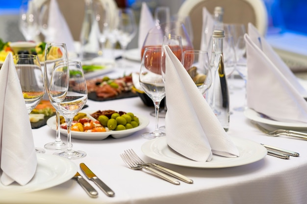 Fabric napkins on a banquet table, festive table setting in a restaurant